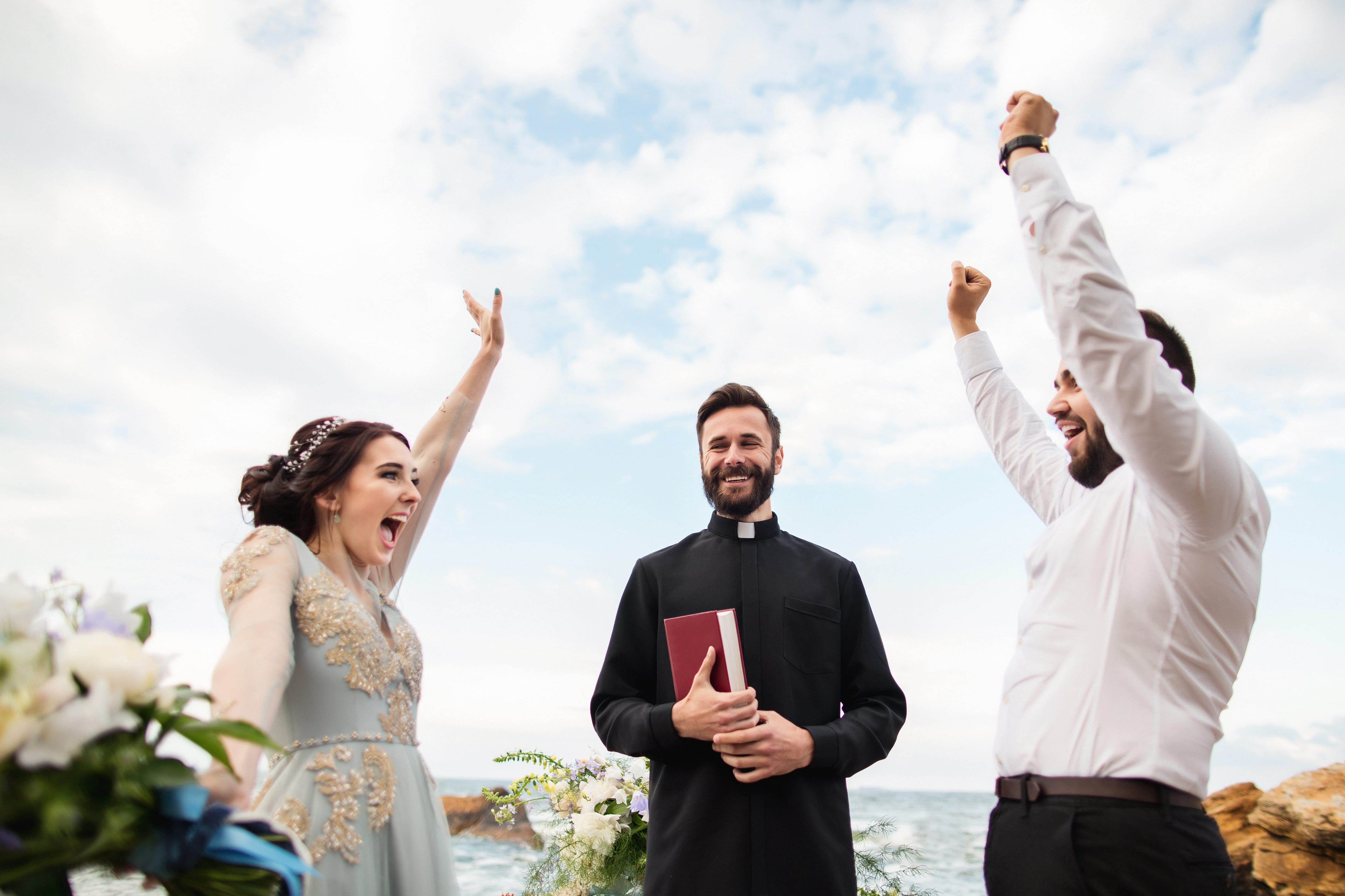 Ordained Minister officiating at a wedding