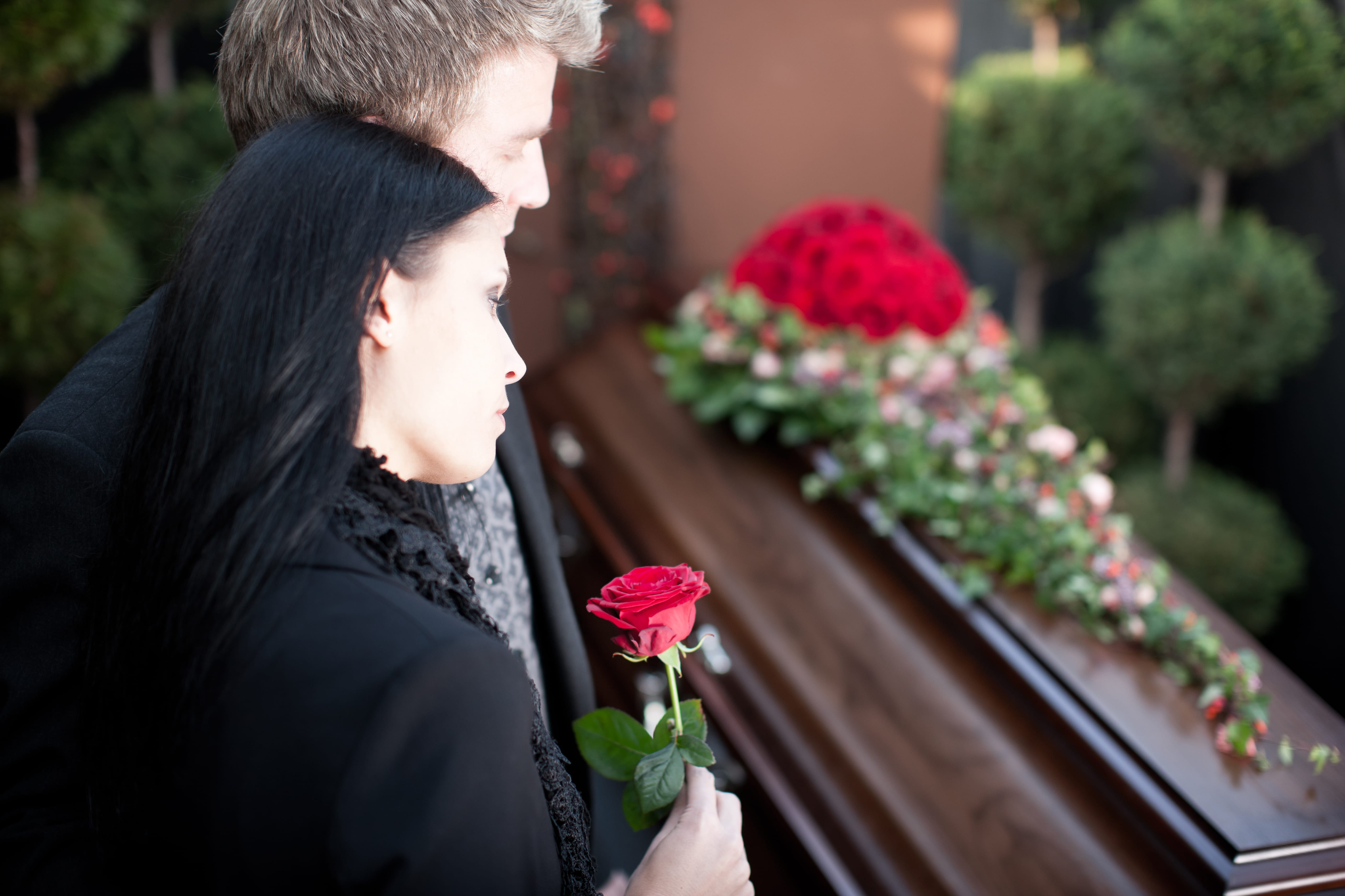 Grieving family at funeral service