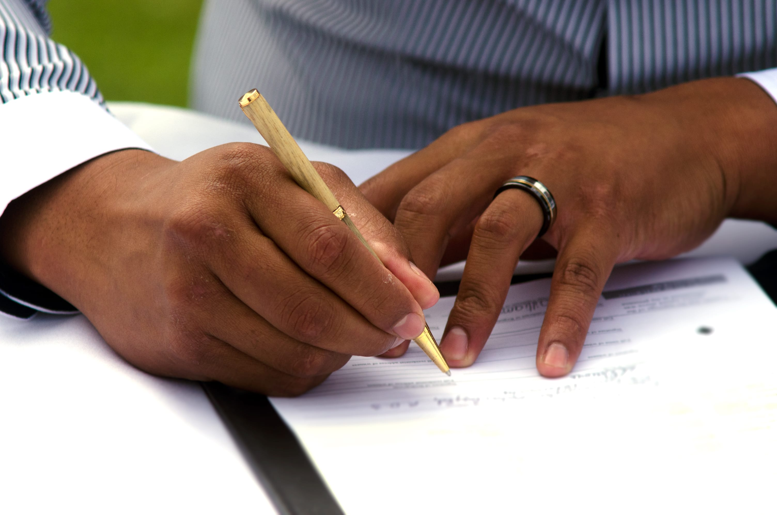 Ordained Minister signing marriage certificate